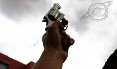 Ilustração; arma apontada em uma laje